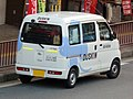 The rearview of Daihatsu HIJET CARGO (EBD-S321V) used as a commercial vehicle of DUSKIN Nabata.jpg