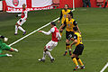 Theo Walcott cross to RVP 3 (Goal!) (6824064627).jpg