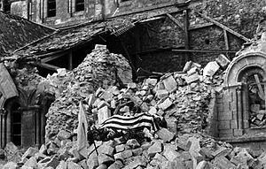 Thomas D. Howie - The flag-draped body of Maj. Thomas Howie rests on the rubble of the St. Lo Cathedral, 1944 (National Archives)
