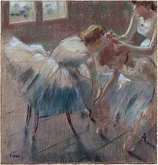 Three Dancers Preparing for Class