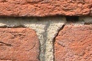 Mortar (masonry) - Mortar holding weathered bricks