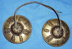 Tingsha - Tibetan tingsha bells with the mantra Om Mani Padme Hung mantra written round them.