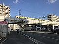 Train of Nishitetsu Kaizuka Line on north side of Nishitetsu-Kashii Station.jpg