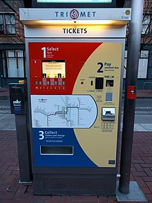 A TriMet ticket vending machine with a ticket validator next to it 966c49fe0796
