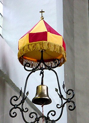 Minor basilica - Tintinnabulum and conopaeum, (Apostolic bell and umbrella) are unique ornamental privileges granted to Roman Catholic basilicas. Minor Basilica of Our Lady of Consolation, Vilvoorde, Belgium.
