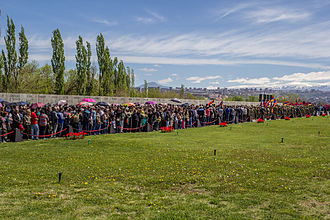 Tsitsernakaberd - Mourners walk past the memorial wall which flanks the left side of the esplanade (April 24, 2014)