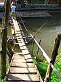 Two-plank footbridge to stairs across water.jpg