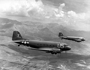 Two aircraft flying over mountainous terrain