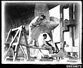 Two sailors cleaning a propeller of the French warship BELLATRIX, 1930-1932 (7633508314).jpg