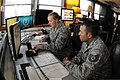 U.S. Air Force Tech. Sgts. Kelly Gonzalez and John Chalupa, with the 219th Security Forces Squadron, North Dakota Air National Guard (NDANG), monitor missile complex activity 130521-Z-WA217-241.jpg