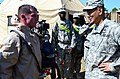 U.S. Army Brig. Gen. Clarence K. K. Chinn, right, the commanding general of the Joint Readiness Training Center and Fort Polk, La., greets Pfc. Caleb Deibeo, a chemical, biological, radiological , and nuclear 120801-A-IA524-208.jpg