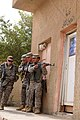 U.S. Army Sgt. Leonardo Tocaven, right, and his fellow Soldiers prepare to breach a door while demonstrating room entry and clearing procedures to Iraqi policemen during training at the Abu Risha Brigade 110719-A-FO214-048.jpg