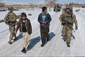 U.S. Army Sgt. Nicholas Fenton, left, and Pfc. Jonathan Murden, walk alongside young boys while on patrol in the city of Gardez, in Paktia province, Afghanistan, Feb. 16, 2012 120216-A-ZU930-017.jpg