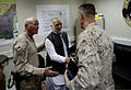 U.S. Marine Corps Gen. Joseph F. Dunford, right, the commanding general of the International Security Assistance Force, greets Helmand provincial Gov. Naeem Baluch, center, during a visit to Main Operating Base 130729-M-RF397-041.jpg