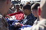 U.S. Marines and Sailors assigned to the 26th Marine Expeditionary Unit (MEU), and Sailors assigned to the USS Kearsarge (LHD 3), fold the American flag to commemorate the Fourth of July during their 2013 130704-M-BS001-007.jpg