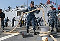 U.S. Navy Fire Controlman 3rd Class Jeromy Fisher, center, heaves a mooring line aboard the guided missile destroyer USS Momsen (DDG 92) in Jakarta, Indonesia, May 24, 2013, before getting underway in support 130524-N-YU572-025.jpg