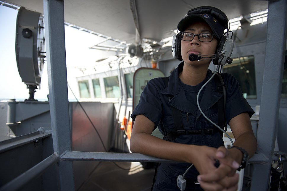 U.S. Navy Quartermaster Seaman Arielle Cox stands watch as the guided missile destroyer USS Arleigh Burke (DDG 51) prepares to depart Bahrain following a scheduled port visit June 6, 2014 140606-N-WD757-013
