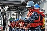 U.S. Navy Seaman Jalen Smith tends the phone and distance line between the amphibious assault ship USS Bataan (LHD 5) and the fleet replenishment oiler USNS Big Horn (T-AO 198) during a replenishment-at-sea 130516-N-JX484-011.jpg