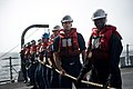 U.S. Sailors heave a line during an underway replenishment aboard the guided missile destroyer USS William P. Lawrence (DDG 110) Aug. 26, 2013, in the Arabian Sea 130826-N-ZQ631-004.jpg