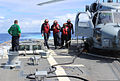 U.S. Sailors inspect the flight deck of the guided missile destroyer USS Kidd (DDG 100) in the Indian Ocean March 16, 2014 140316-N-ZZ999-002.jpg