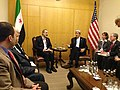 U.S. Secretary of State John Kerry meets with Syrian Opposition Council Chairman Moaz al-Khatib in Istanbul, Turkey on April 20, 2013.jpg