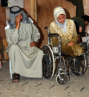 Disability - A 28-year-old Iraqi woman who lost both of her legs during the Iraq War in 2005
