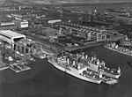 USS Albemarle (AV-5) and USS Curtiss (AV-4) fitting out at the Philadelphia Naval Shipyard in late 1940 (NH 96539).jpg