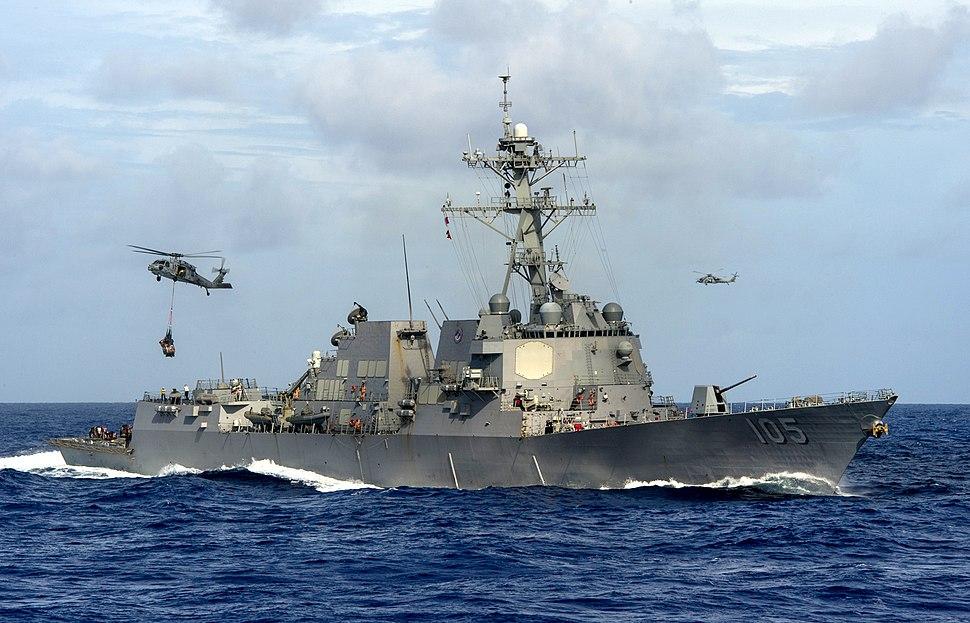 USS Dewey conducts a replenishment.