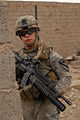 US Army 51059 BAGHDAD - Pfc. Dan Cesiastis, an infantryman from Worcester, Mass., takes up a spot between cinder block walls to pull security while on a joint patrol with Iraqi Army Soldiers of the 44th Brigade, 11.jpg
