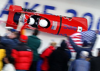 2002 Winter Olympics - U.S. Bobsled Team makes their way down the track at Utah Olympic Park during the men's two-man bobsled event at the 2002 Winter Olympic Games.