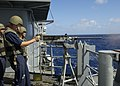 US Navy 030225-N-4649C-001 Gunner's Mate 3rd Class Randy Peck from Krotz Springs, La., fires a few rounds from the ship's .50 cal weapons mount during a small arms firing exercise.jpg