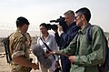 US Navy 030331-N-5362A-012 A member of the British Royal Marines speaks to NBC's Today's show anchor Ann Curry about the recent arrival of water and food supplies by British and American troops at Iraq's southern port city of U.jpg