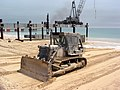 US Navy 030404-N-1050K-010 U.S. Navy Seabees assigned to Amphibious Construction Battalions One and Two continue to smooth the beaches for future operations in preparation for the completion of the at Camp Patriot.jpg