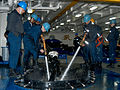 US Navy 030425-N-9563N-502 Sailors spray water on an anchor chain to clean the salt off as it is being pulled out of the sea aboard USS Theodore Roosevelt (CVN 71).jpg