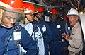 US Navy 030623-N-6651N-022 Master Chief Damage Controlman Thomas J. Wrobel explains to the Number 1 Hose Team how the location of the fire would impact the way they would approach it during a fire drill aboard the USS John F.jpg