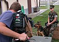 US Navy 030826-N-2893B-001 Master-at-Arms 2nd Class Ashleigh Pankratz and her partner Nero, are interviewed on videotape.jpg