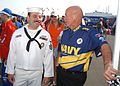US Navy 040403-N-1328C-508 Electrician's Mate 1st Class Glenn Williams, of El Paso, Texas, left, talks with Mr. John Cleek, of Mooreville, N.C., a team member with the U.S. Navy sponsored Fitz-Bradshaw NASCAR racing team at Tex.jpg