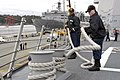 US Navy 040513-N-6477M-004 Boatswain's Mate 3rd Class Crystal Thompson takes the number two mooring line off the bits.jpg