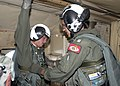 US Navy 040922-N-2559S-013 Aviation Electronics Technician Airman David J. Everly from Slidell, La., receives a final check on his parachute harness.jpg