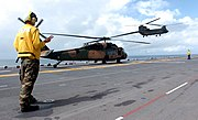 US Navy 050612-N-8146B-001 An Australian Army S70A-9 Black Hawk and a CH-47D Chinook assigned to Australian 5th Aviation Regiment, conduct flight operations from the flight deck of the amphibious assault ship USS Boxer (LHD 4)