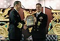 US Navy 051017-N-2383B-036 Chief of Naval Operations (CNO) Adm. Mike Mullen congratulates former Commanding Officer, USS Hampton (SSN 767), Cmdr. Robert P. Burke during the Twenty-fifth Annual Vice Admiral James Bond Stockdale.jpg