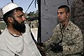 US Navy 051116-M-7747B-005 U.S. Navy Hospitalman Janathan Casale takes the blood pressure of a Pakistani man at a camp in Pakistan.jpg