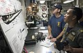 US Navy 060621-N-9851B-001 U.S. Navy diver Hospital Corpsman 2nd Class Brad O'Keefe shows Royal Lt.j.g. Mongkol Podang a drawing of USS Lagarto (SS 371) during a visit to rescue and salvage ship USS Salvor (ARS 52).jpg