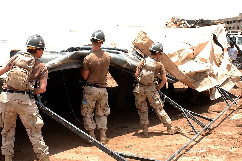 File:US Navy 060821-N-7770P-002 A team of U.S. Navy Seabees assigned to Naval Mobile Construction Battalion Five (NMCB 5), attached to Combined Joint Task Force Horn of Africa (CJTF HOA), set up tents.jpg