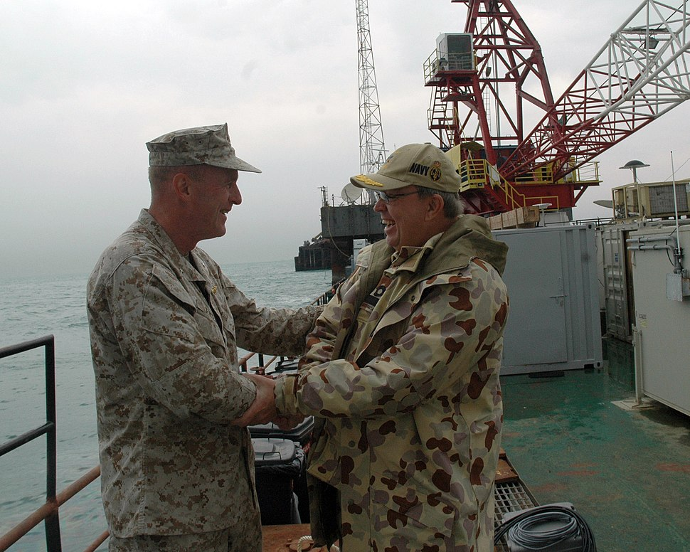 US Navy 061112-N-9268E-001 U.S. Marine Brig. Gen. Carl Jensen bids Royal Australian Commodore Peter Lockwood farewell after turning over the Combined Task Force One Five Eight (CTF) 158 mission