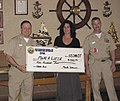 US Navy 070105-N-0553S-003 Senior Chief Hull Technician Mark A. Williams, president of the Shipyard Chief Petty Officer Association (CPOA) presents a check to Cyndi Sheehan, development director for Make-A-Wish Foundation of Ha.jpg
