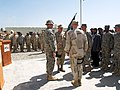 US Navy 070411-N-0000X-002 Cmdr. Dave Adams receives the guidon from the commanding officer of the 82nd Airborne Division 4th Brigade Combat Team during a change of command ceremony for Provincial Reconstruction Team Khost.jpg