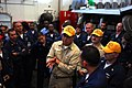 US Navy 071129-N-7526R-062 Senior Chief Ship's Serviceman (AW-SW) Hector Razo discusses a training evolution with repair locker 1B after a drill in the hangar bay of the aircraft carrier USS Ronald Reagan (CVN 76).jpg