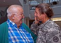 US Navy 081113-N-2555T-046 Chief Storekeeper Marie Toffolo cries as she is greeted by her father during her return from a nine-month individual augementee tour in Gardez, Afghanistan.jpg