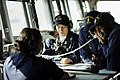 US Navy 081130-N-0718S-705 Quartermaster 1st Class Jerry L. Rozier checks the navigational chart in the pilot house of the amphibious command ship USS Blue Ridge (LCC 19) as the ship departs Hong Kong after a routine port visit.jpg